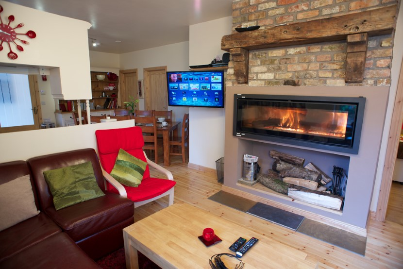 coach house  lounge roaring fire.jpg